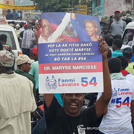 Haiti Election 2016 - Lavalas Supporter holding Maryse Narcisse poster with Aristide