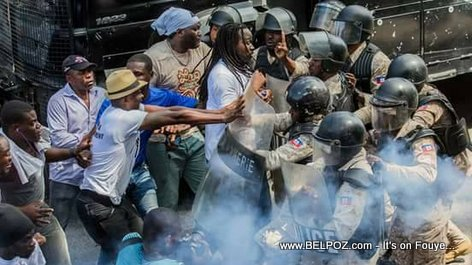 Manifestation in Haiti - Senator Don Kato forcing his way through a Police Baricade