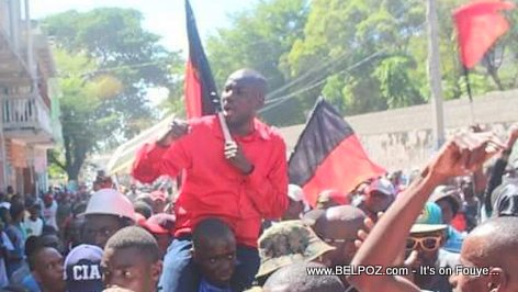 Moise Jean Charles and his black and red (noir et rouge) flag