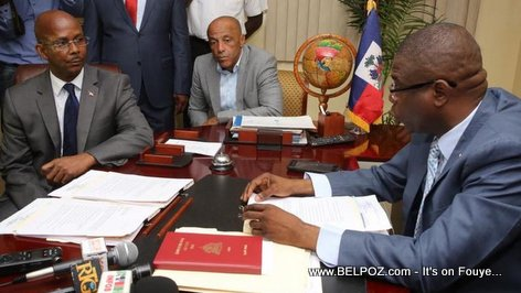 PHOTO: Prime Minister Jean Michel Lapin submits his documents to Senate president Carl Murat Cantave