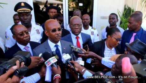 Haiti Prime Minister Jean Michel Lapin talks to the media while leaving the Parliament building