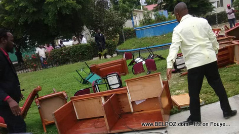 Senator Ricard Pierre and Don Kato drag a Senate desk outside to prevent ratification session of PM Lapin