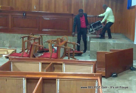 Opposition Senators Don Kato and Ricard Pierre removing electronic devices from the Senate