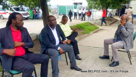4 opposition Senators sit outside of parliament after they destroyed the Senate