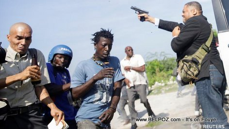 Haiti Senator Ralph Fethiere with his gun shooting towards the crowd