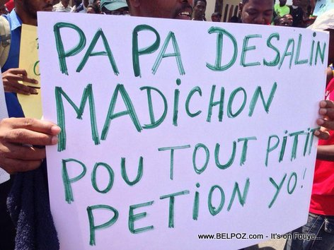 Haitian street protest sign ask our forefather Dessalines to curse all the sons and daughters of Petion