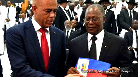 Michel Martelly passes the Presidential Sash to Jocelerme Privert